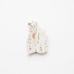 Maria Morganti, Nel Travertini #7, 2015, Pieve a Presciano, plasticine, travertine, 17 x 11 x 1,5 cm max. Courtesy Otto Zoo. Ph. Luca Vianello.