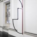 Stefano Comensoli_Nicolò Colciago, Abbraccio sospeso (Sigillo_08), 2020, led tube, iron tube, virgin polyethylene tube, aluminium profile, 269x93x5 cm. Courtesy Otto Zoo. Ph. Luca Vianello